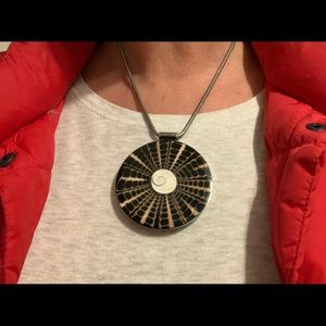 Silver necklace with black/brown/cream medallion